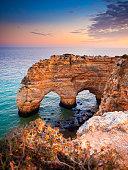 Heart-shaped cliffs on the shore of Atlantic ocean in Algarve, Portugal. Beautiful summer landscape.