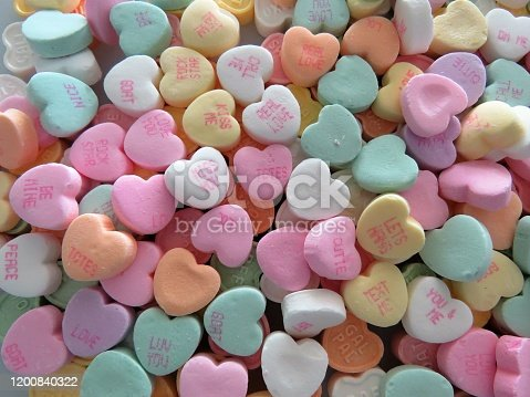 Heart-shaped conversation candies, background, copy space