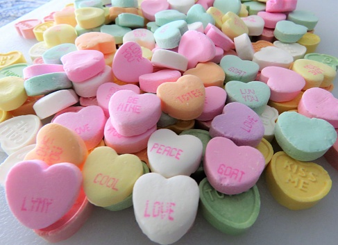 Heart-shaped conversation candies, background