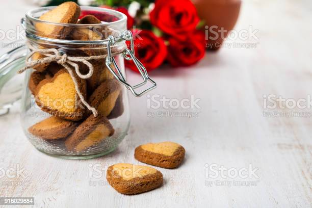 Heartshaped cookies in a glass jar and red roses picture id918029884?b=1&k=6&m=918029884&s=612x612&h=qfsiis6hkdjxwiakipgxol1kxx7oquy1mu ru4potew=