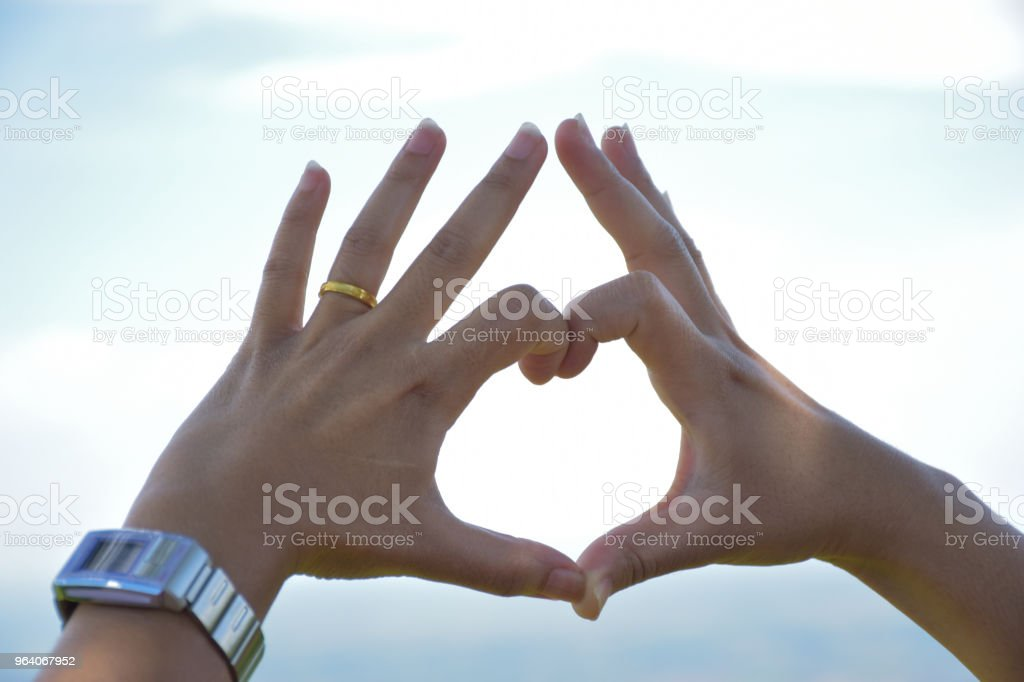 Heart-shaped hands on background sky - Royalty-free Animal Stock Photo