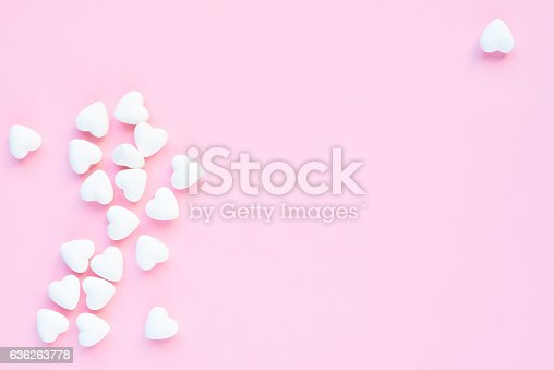 Sweet heart-shaped marshmallows on pink background