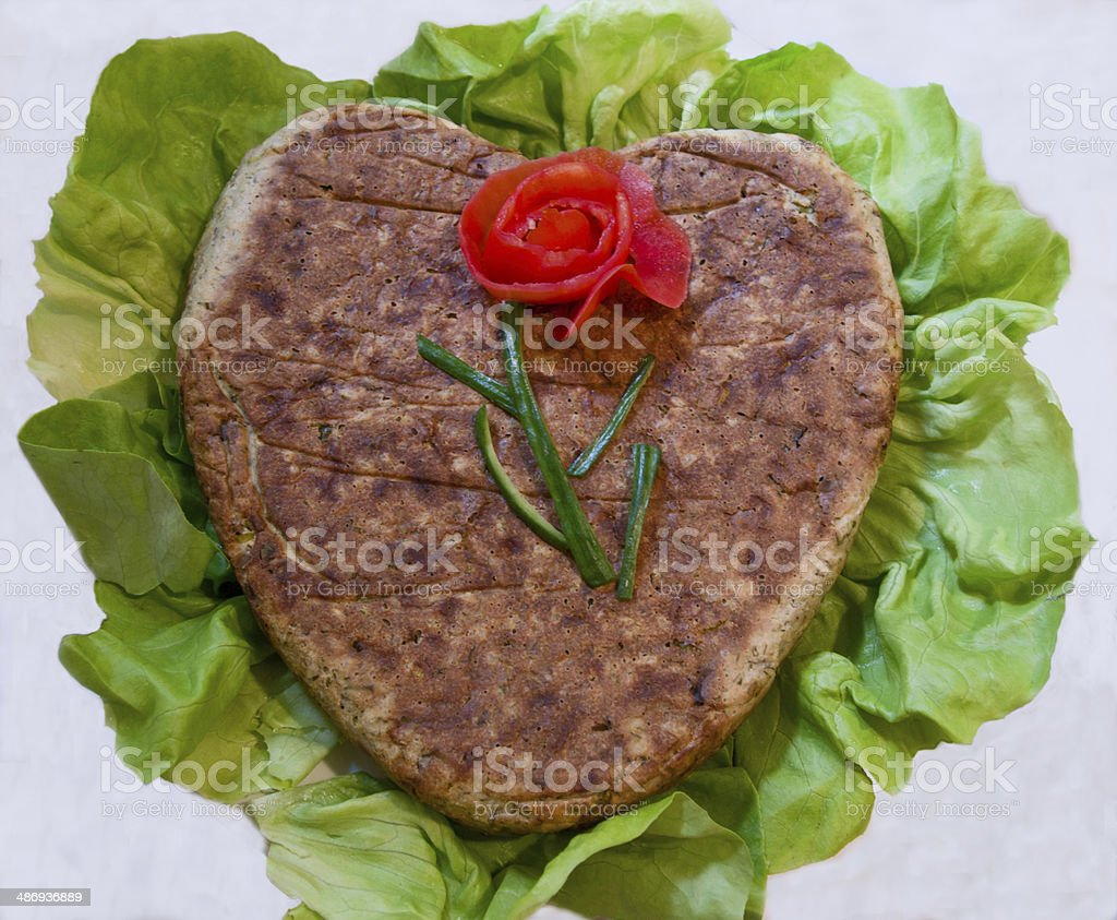 Heart-shaped meet minced with vegetable and tomato rosearrangement royalty-free stock photo
