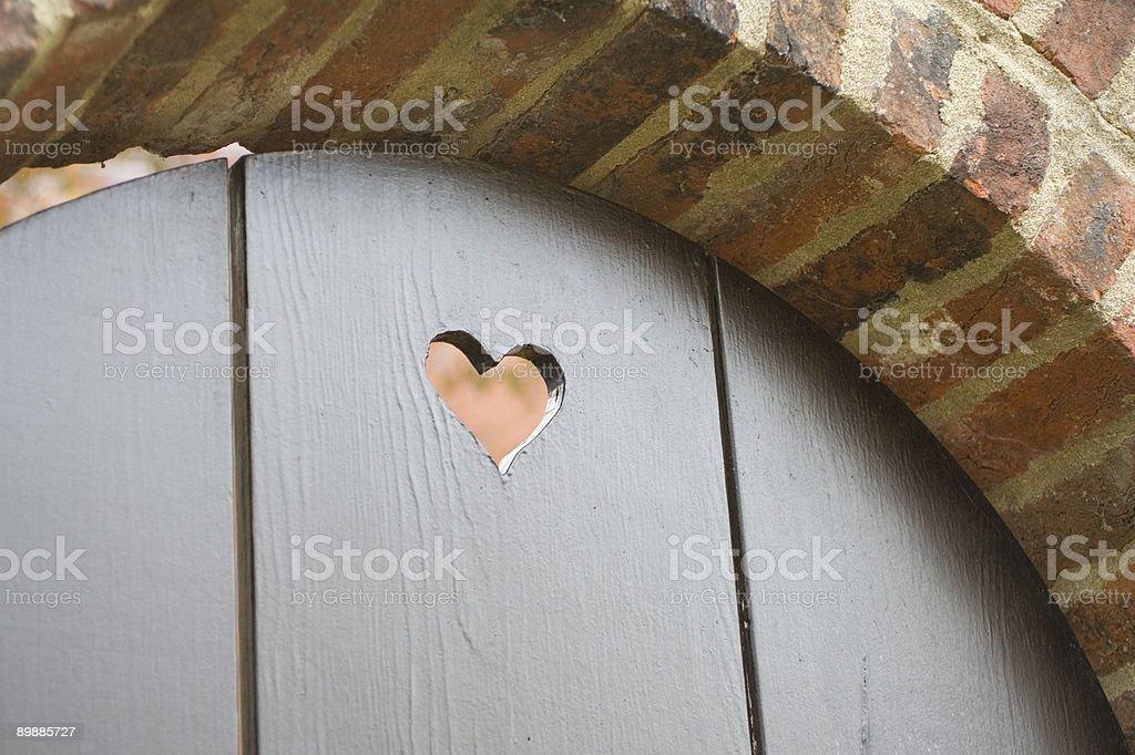 Дверной глазок в форме сердца Стоковые фото Стоковая фотография