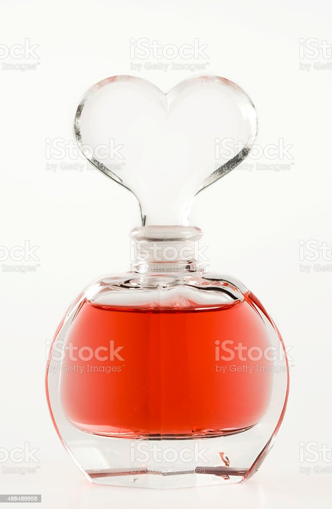 Heart-shaped perfume bottle stock photo