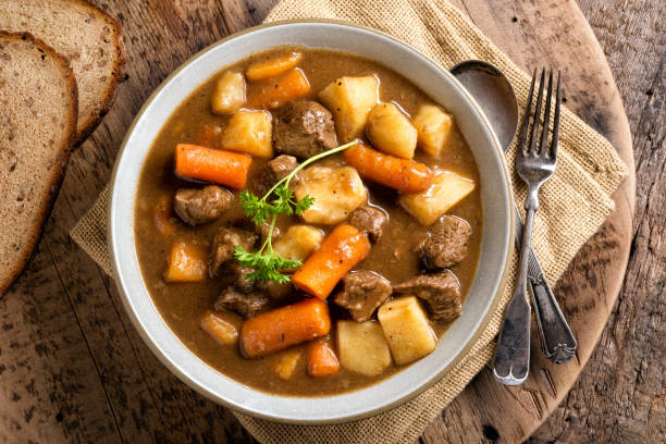 Hearty Beef Stew A bowl of delicious homemade beef stew with carrots, potato, onion and turnip. main course stock pictures, royalty-free photos & images
