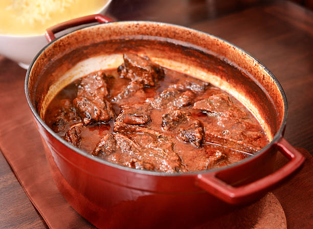 hearty braised beef short-ribs - braised stock pictures, royalty-free photos & images