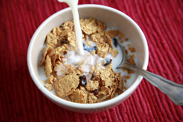 A hearty breakfast of cereal with milk stock photo