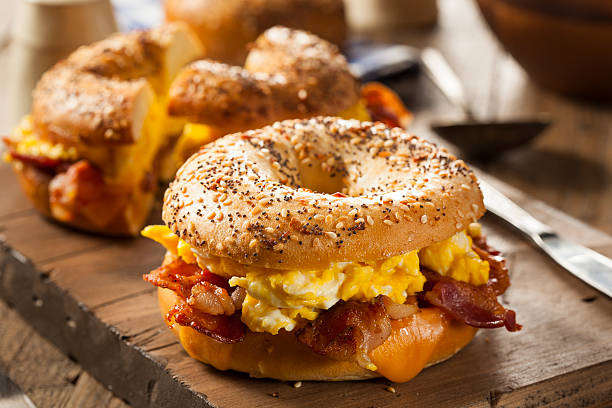 hearty breakfast sandwich on a bagel - cheese sandwich bildbanksfoton och bilder