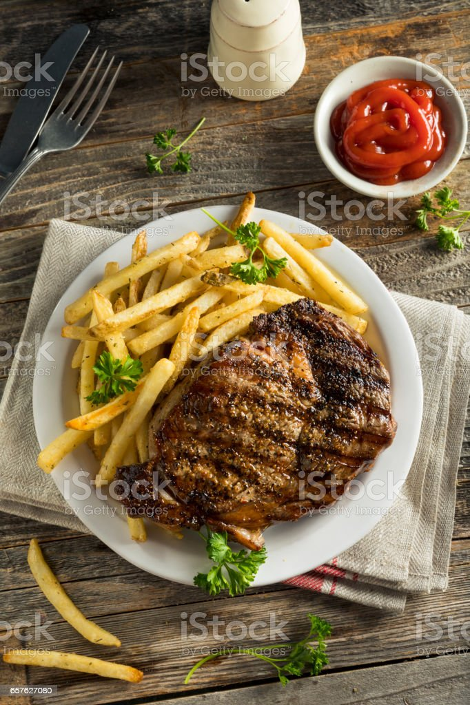Hearty Homemade Steak and French Fries stock photo