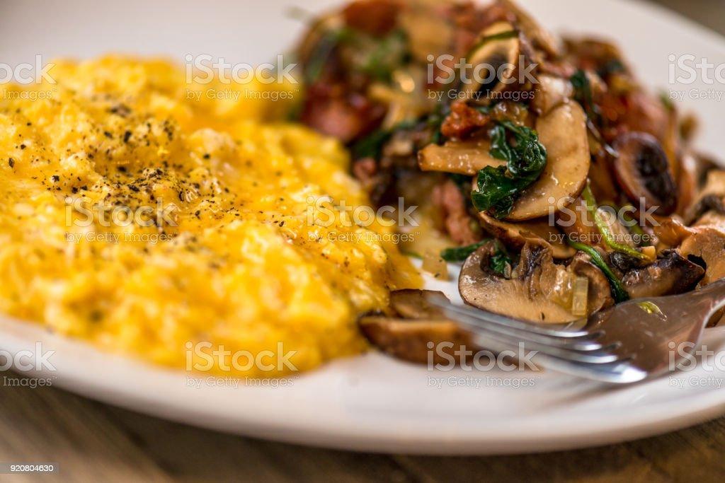 Hearty scrambled egg and mushroom breakfast stock photo