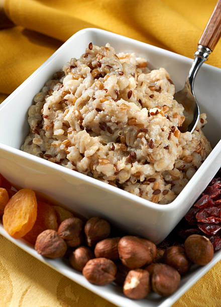 Hearty Six Grain Hot Cereal with nuts and dried fruit stock photo