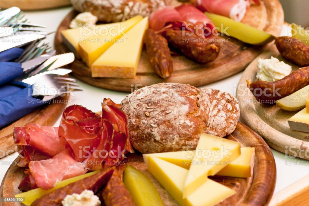 Hearty Tyrolean ham and cheese platters stock photo