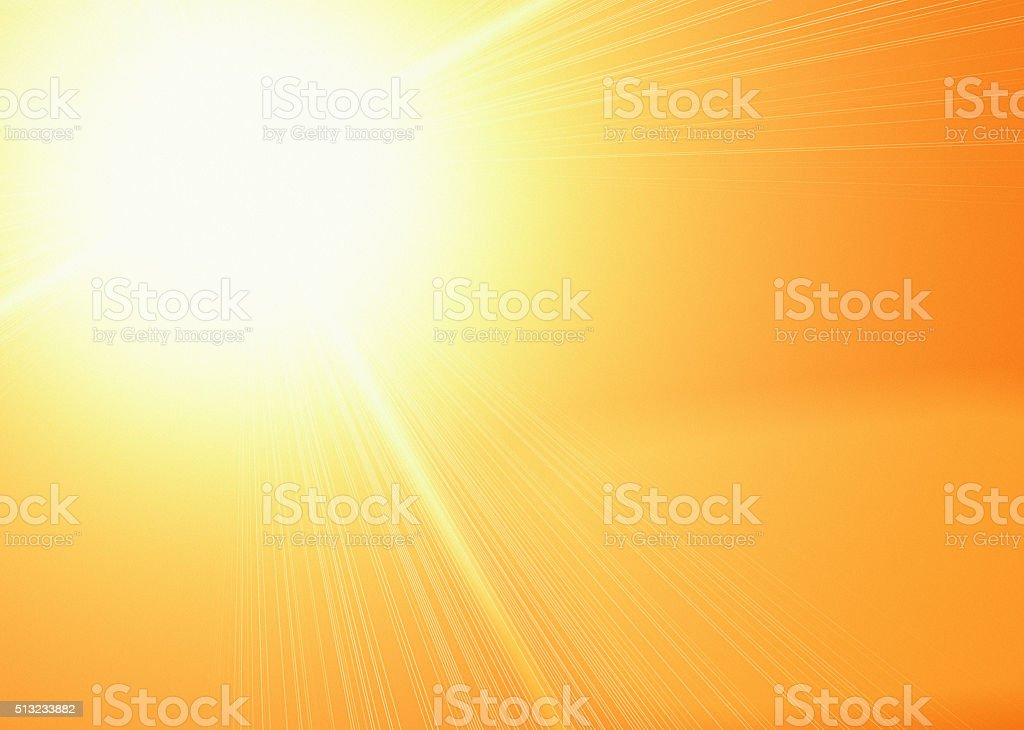 Heat and light: Dazzling sun in a golden sky stock photo