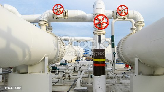istock Heat exchangers in a refinery. Heated gasoline air cooler. The e 1126392682