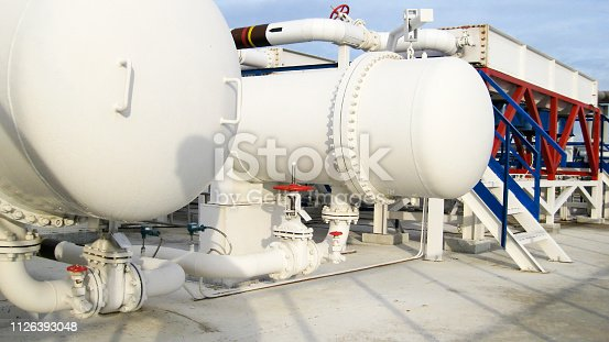 istock Heat exchangers in a refinery 1126393048