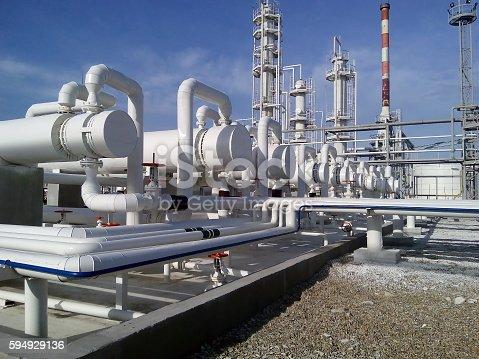 istock Heat exchangers in a refinery 594929136