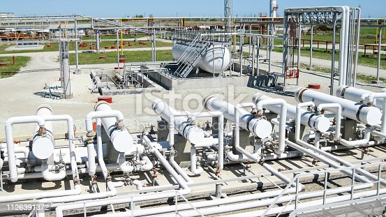 istock Heat exchangers in a refinery. The equipment for oil refining 1126391372