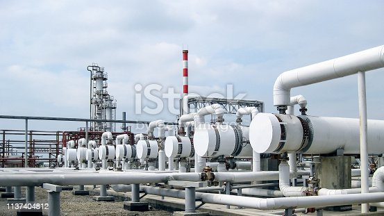 istock Heat exchangers in a refinery. The equipment for oil refining 1137404812