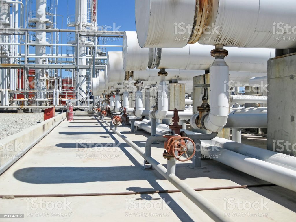 Heat exchangers in a refinery. The equipment for oil refining stock photo
