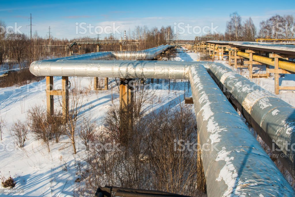 Heat insulation of hot water pipes and thermal main in winter stock photo & Royalty Free Water Main Break Pictures Images and Stock Photos - iStock