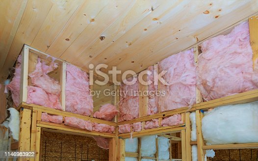 466705128 istock photo Heat isolation in a new house with mineral wool, home wood 1146983922