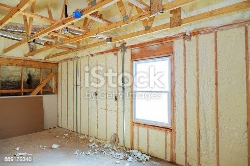istock Heat isolation in a new prefabricated house with mineral wool and wood. 889176340