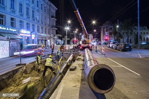 Riga, Latvia - August 9, 2016: Heat pipe replacement works on Brivibas Street at night