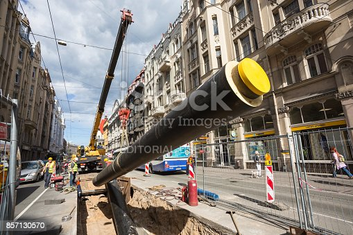 Riga, Latvia - August12, 2016: Heat pipe replacement works on Brivibas Street. A pipe is being laid in a prepared trench.