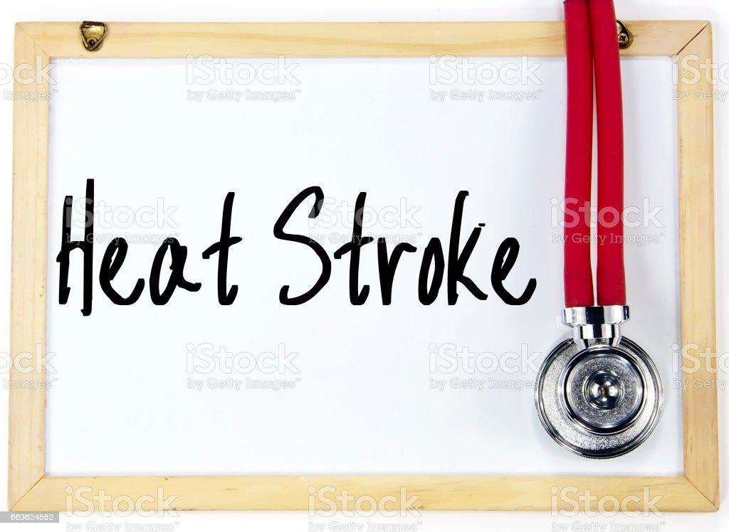 heat stroke text write on blackboard stock photo
