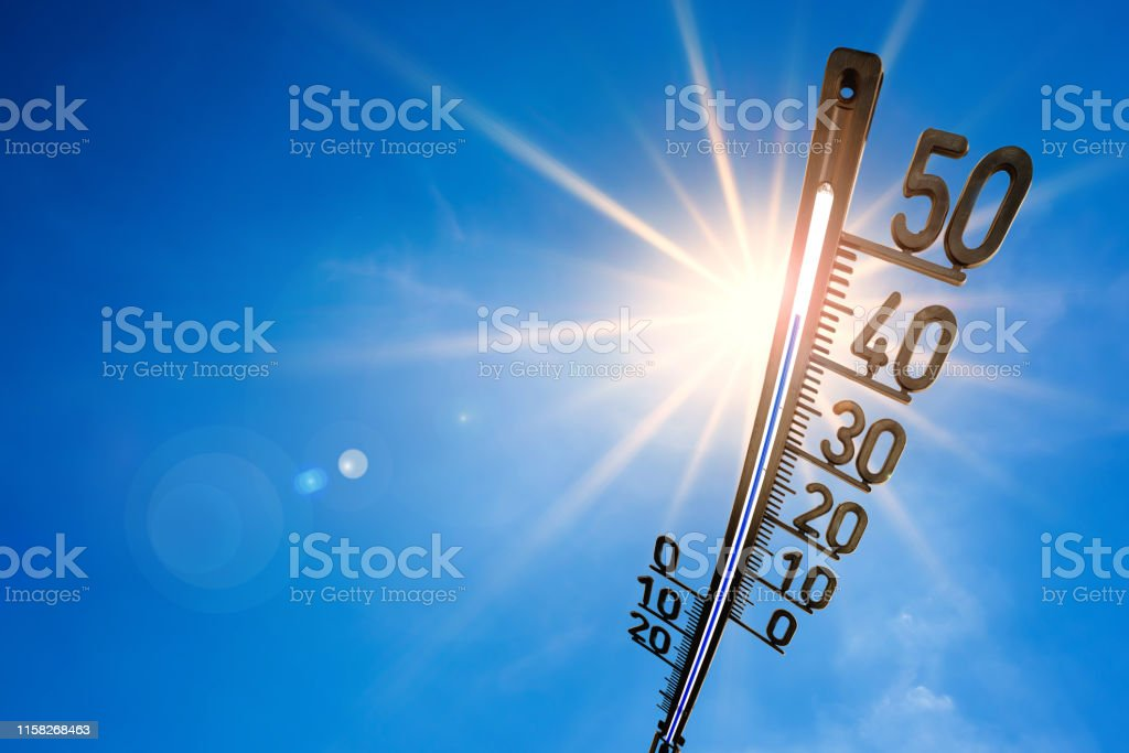 Hot summer or heat wave background, bright sun on blue sky with...