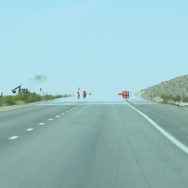 Heat Wave Water Mirage Illusion on Highway Road, Nevada Desert, stock photo