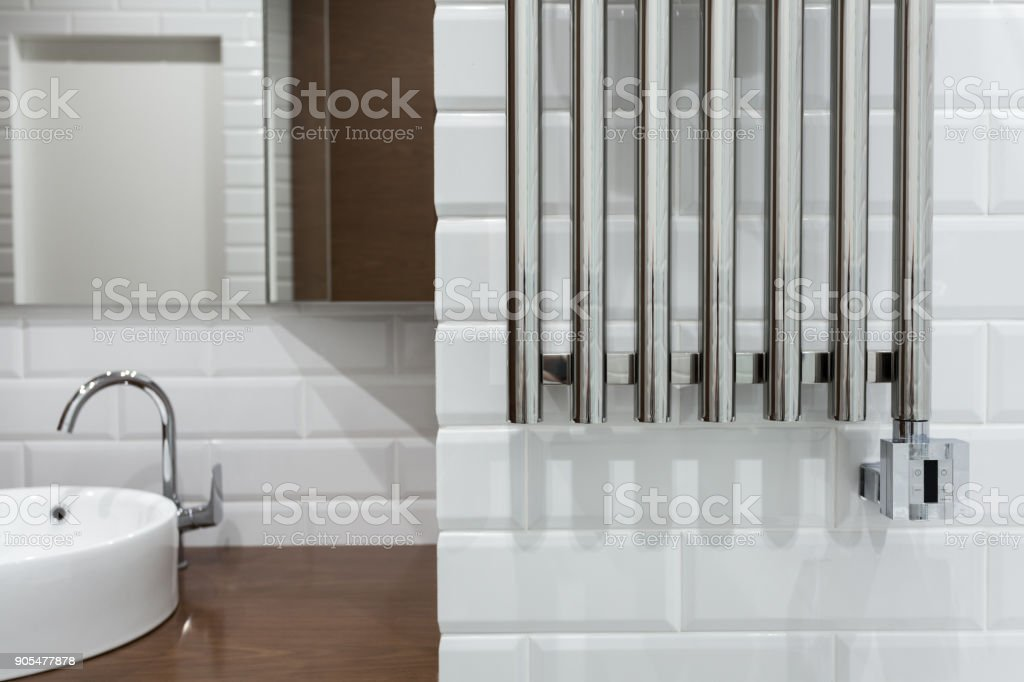 Heated towel rail in the bathroom. Towel warmer in bathroom. stock photo
