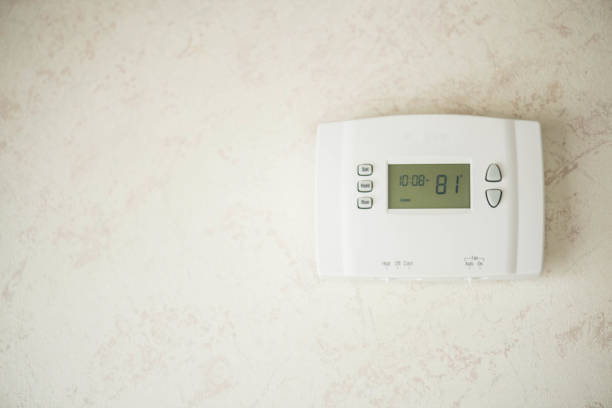 Heater and AC thermostat stock photo