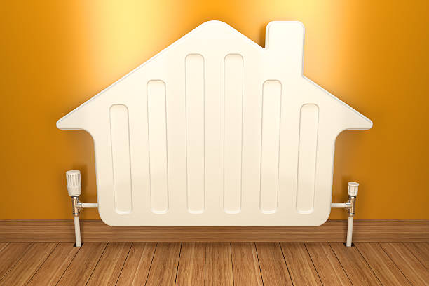 heater radiator on yellow wall in house. 3d image - warm house stock photos and pictures