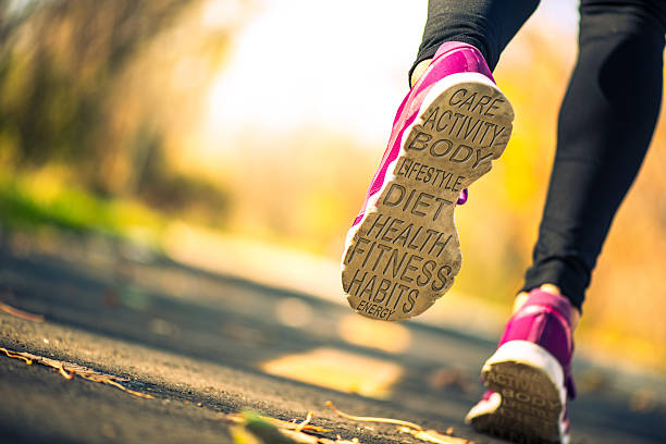 heath related word cloud on a runner's shoe soles Conceptual photo showing a heath related word cloud on a runner's sports shoe soles  sole of foot stock pictures, royalty-free photos & images