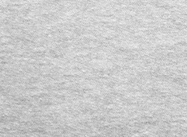 heather gray cotton sweater knitted fabric texture - textile stock photos and pictures