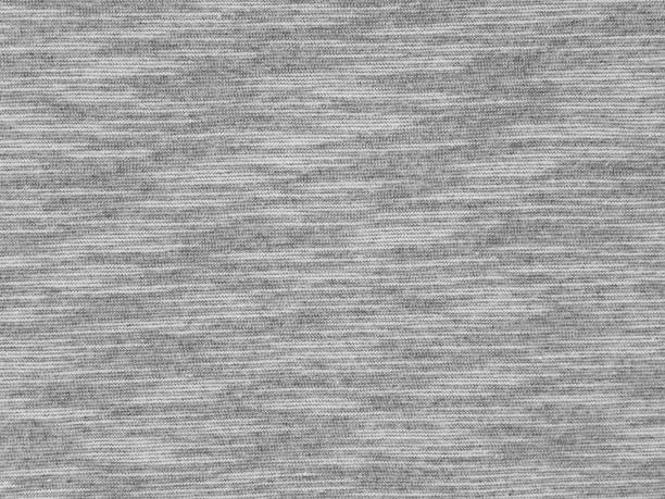 Heather gray t-shirt cotton knitted fabric Heather gray t-shirt cotton knitted fabric texture swatch heather stock pictures, royalty-free photos & images
