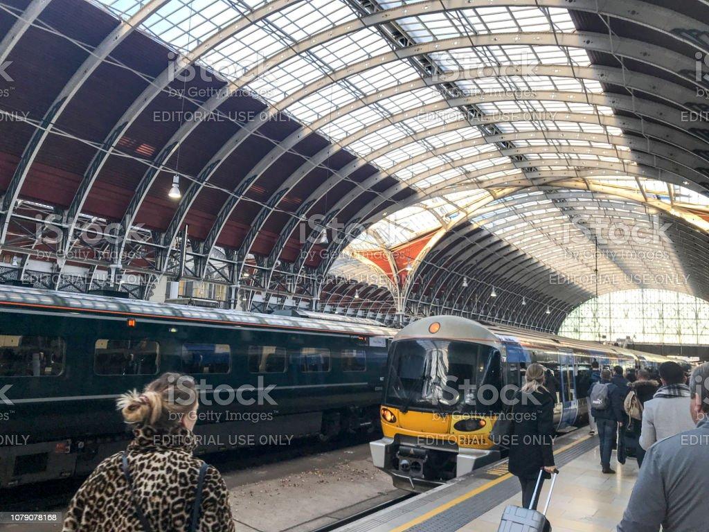 Heathrow express train boarding paddington station stock photo