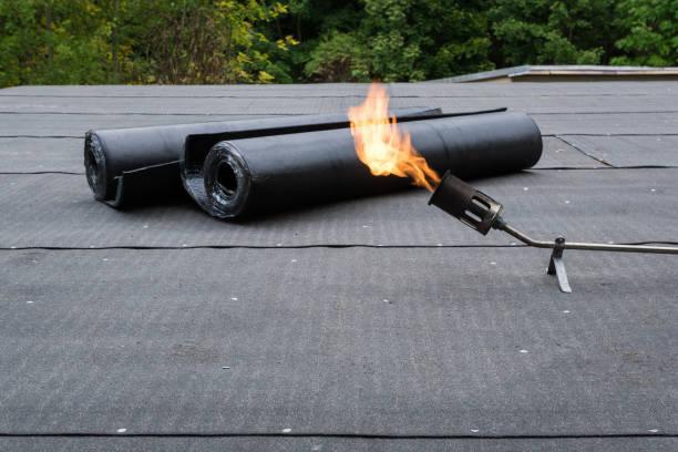 Heating and melting bitumen roofing felt Flat roof installation stock photo