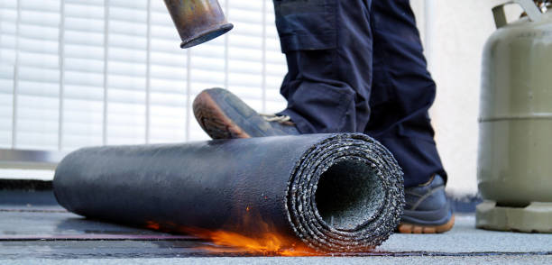 Heating and melting bitumen roofing felt. Flat roof installation with propane blowtorch during construction works with roofing felt. Roofing felt. Roofer working tool. Waterproofing, panoramic view stock photo