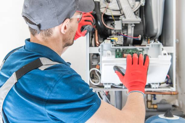 Heating Central Gas Furnace Heating Central Gas Furnace Issue. Technician Trying To Fix the Problem with the Residential Heating Equipment. repairing stock pictures, royalty-free photos & images