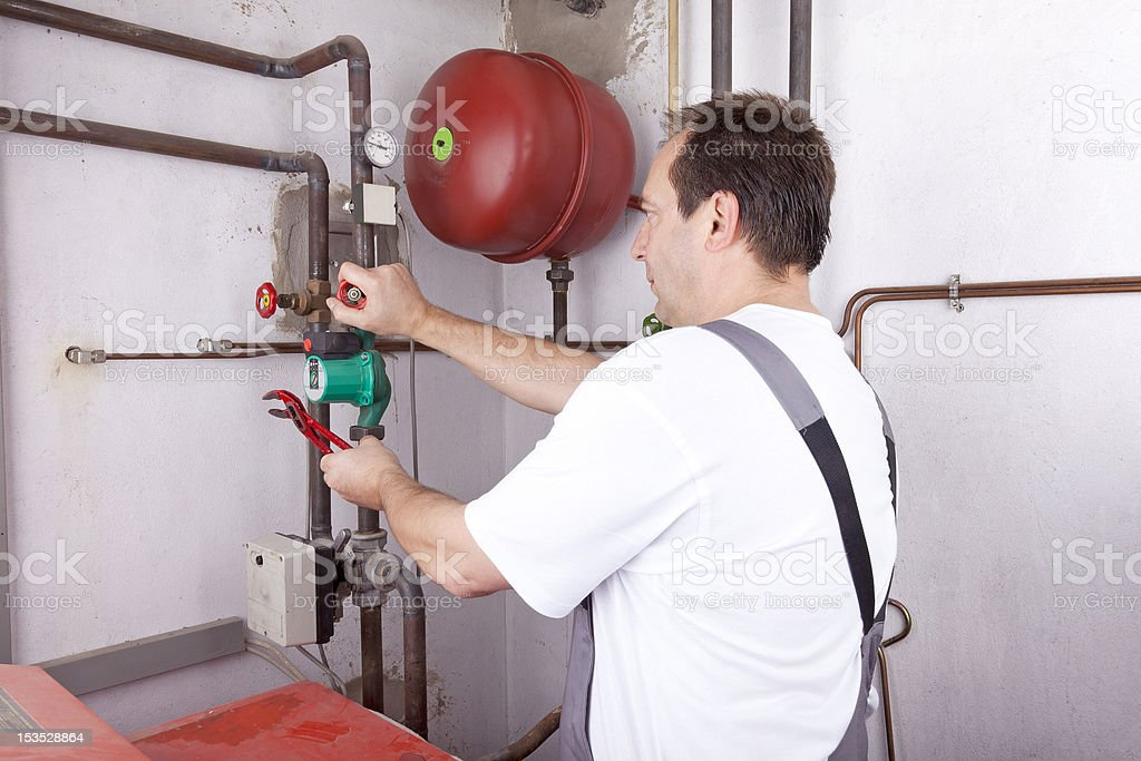 heating engineer at work stock photo
