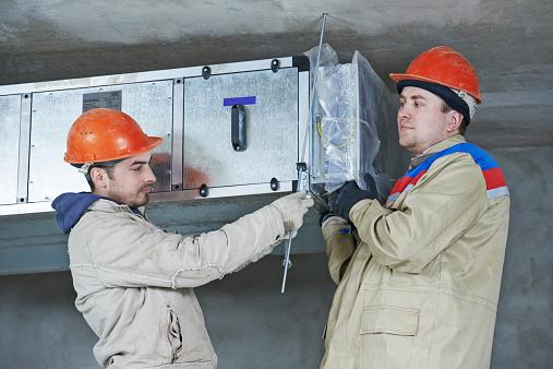 istock heating engineer repairman in boiler room 523181729