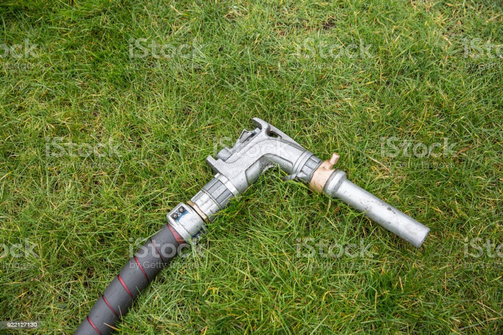 Heating oil delivery, fuel nozzle laid on the floor stock photo