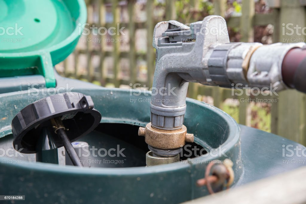 Heating oil delivery, nozzle placed into oil tank to refill stock photo