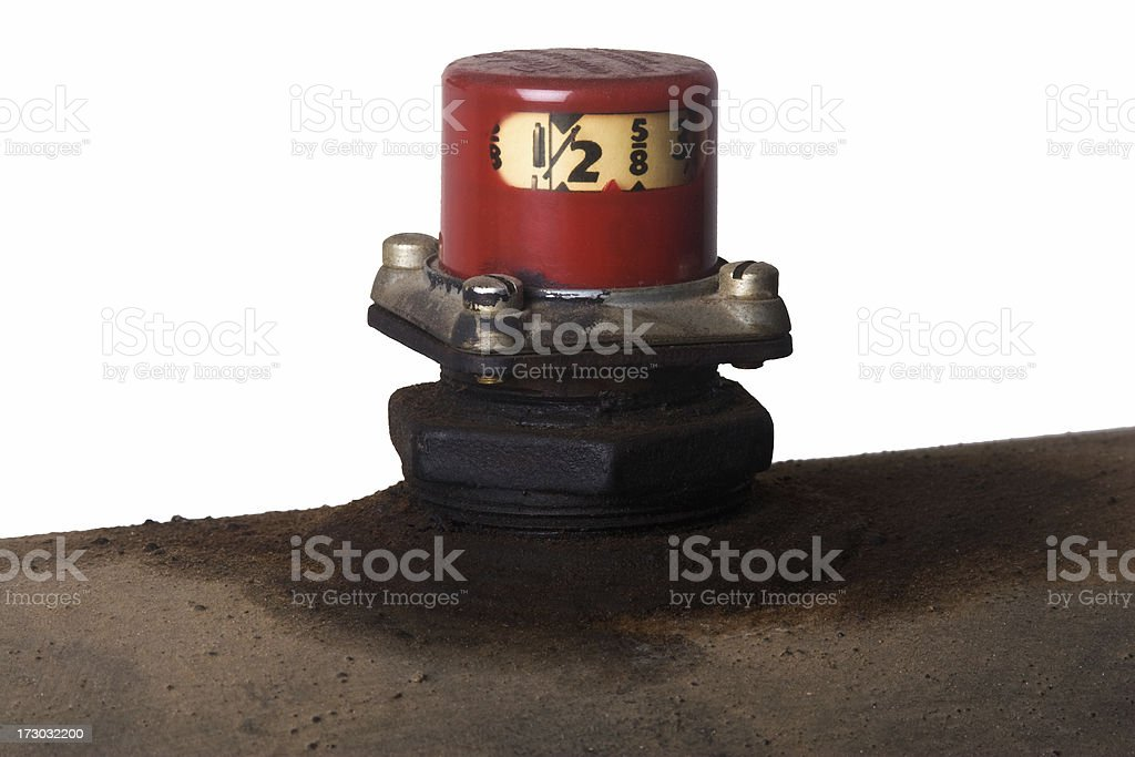 Heating oil tank and red gauge isolated against white stock photo