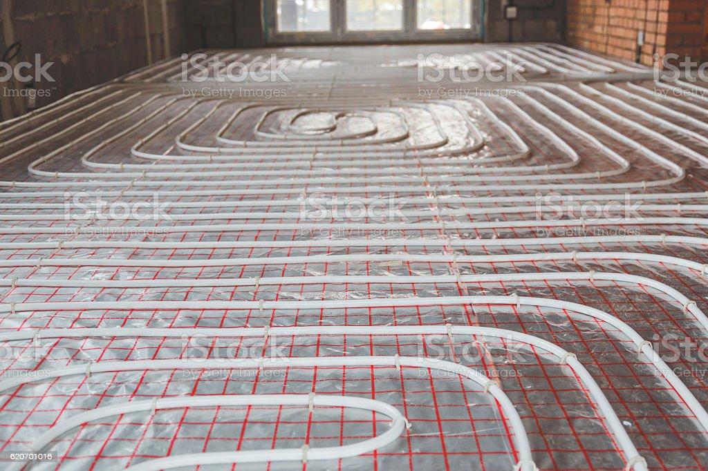 Heating posed in a under construction building - Zbiór zdjęć royalty-free (Biały)