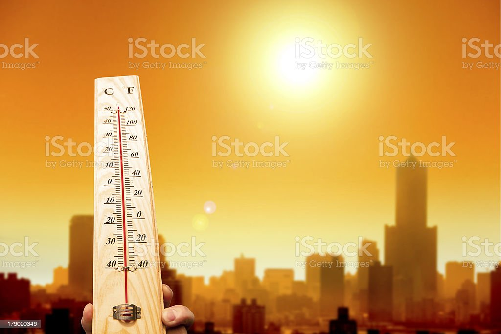 heatwave in the city and hand showing thermometer stock photo