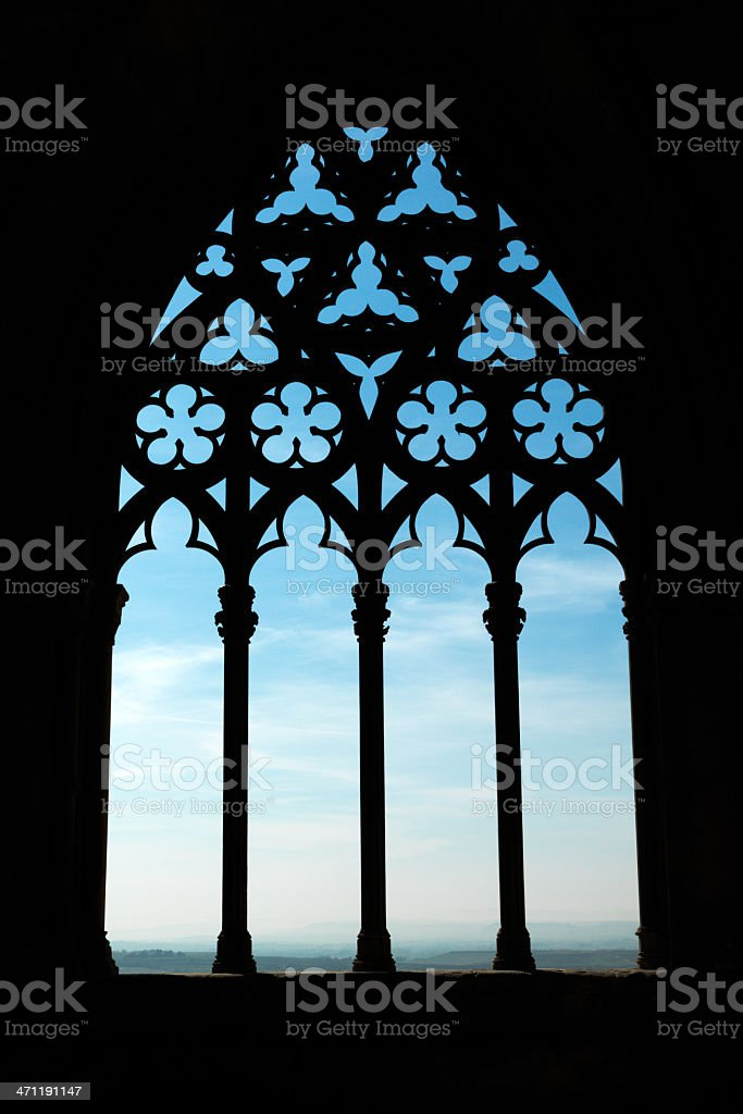 Heaven through ancient cathedral window stock photo